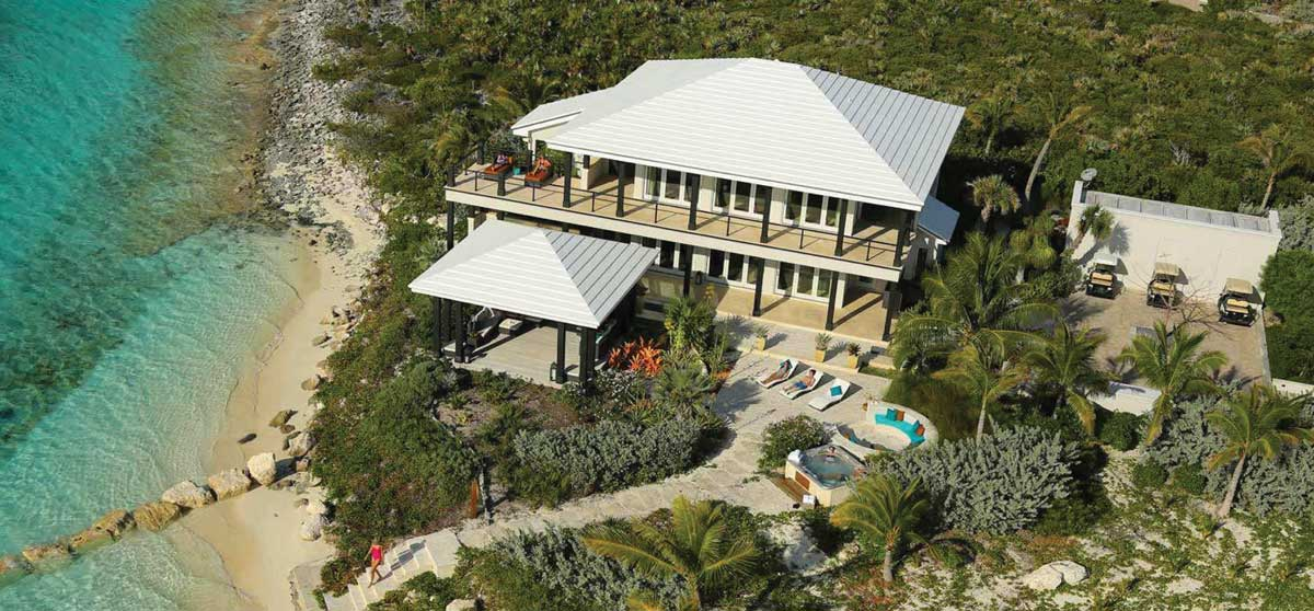 Villa 2, the villa blends into the native and natural landscape, sitting just off of the beach.
