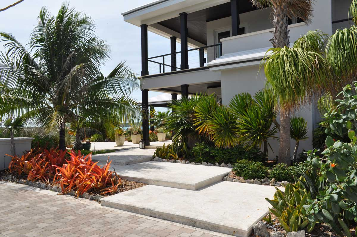 Villa 2, shallow wide steps invite you into this beautiful garden entrance.