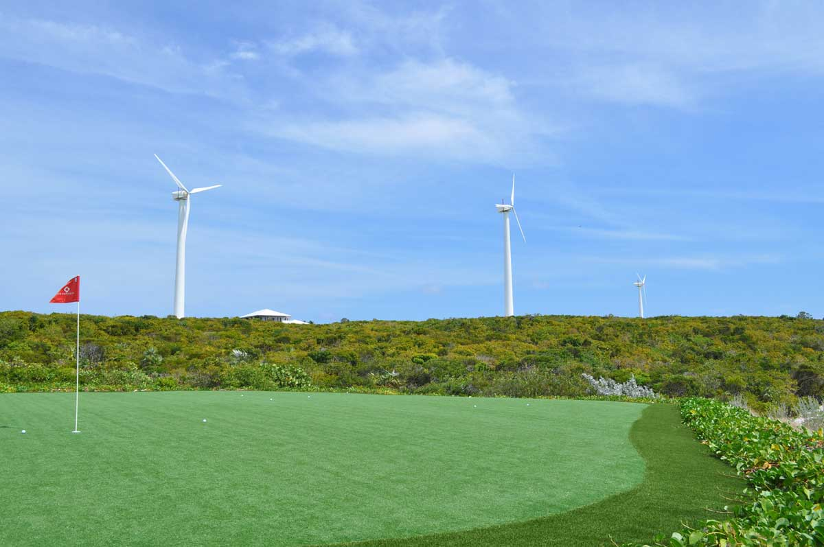 Island amenities include a 9 hole, par 3 synthetic turf golf course. Wind turbines combined with a solar array farm provide power for the Cay.